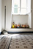 Collection of figurines from Snow White and the Seven Dwarfs in window niche