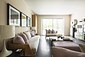 Elegant living area with white table lamps and upholstered wooden sofas
