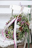 Autumn wreath with ribbon and lace trim on old chair