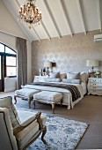 Glamorous French-style attic bedroom