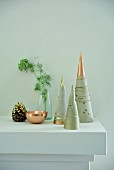 Stylised Christmas trees made from concrete cones with metallic paint
