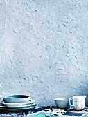 Stack of plates, jug and bowl