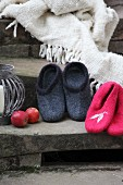 Hand-made felt slippers and fringed blanket on vintage stone steps