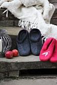 Hand-made felt slippers and fringed blanket on vintage stone steps
