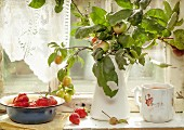 Apples and fresh strawberries on a old windowsill