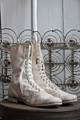Pair of old boots in front of mattress springs