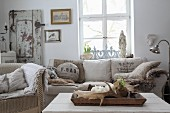 Antlers on tray in front of sofa with scatter cushions made from old flour sacks