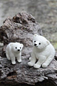 Two hand-made, felted, woollen polar bears