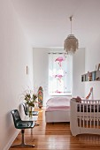 Cot, flamingo-patterned curtains and waiting-room bench in bedroom