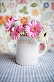 Flower arrangement of gerbera daisies in a mug
