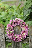 Wreath of clover flowers on weathered picket fence