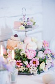 Flower arrangement and petit fours on cake stand