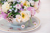Festive flower arrangement of delicate spring flowers