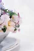 Flower arrangement in vintage bowl