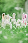 Whimsical felt bunnies hidden amongst grass