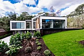 Modern, cubist architect-designed house in garden