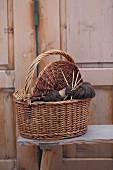 Knitting in knitting basket in front of rustic wooden door