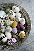 Easter eggs variously decorated in antique silver dish