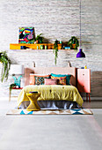 Wall board with colorful accessories over double bed in the bedroom with silk wallpaper
