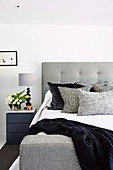 Modern upholstered bed in shades of gray