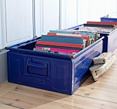 Books stored in blue metal cases
