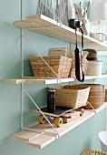 Baskets, skateboard and camera on String shelves