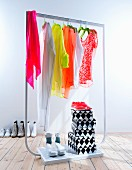 Neon clothes on clothes rack