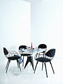 Round dining table, black chairs and red Eiffel tower ornament