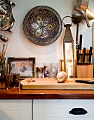 Oriental accessories in rustic kitchen