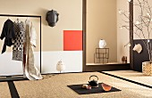 Elegant Japanese room with tatami mats, niche, clothes rail and artworks