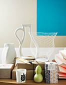 Artistic vessels and Japanese paintbrushes in front of turquoise and beige wall