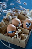 Eggs decorated for Easter with animal stickers in vintage box