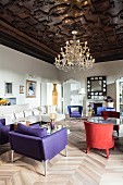 Colourful designer furniture in luxurious living room with coffered ceiling