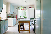 Pale blue cabinets and dining area in retro kitchen