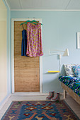 Vintage-style dresses hung from door in bedroom