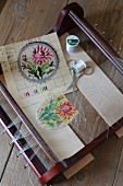 Bead loom, colourful floral beading pattern and beading utensils