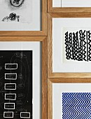 Various drawings in wooden frames on wall