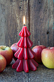 Christmas-tree candle and apples