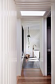 Glance into elegant bathroom with free-standing bathtub and stand mixer