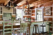 Wooden furniture and exposed beams in rustic kitchen