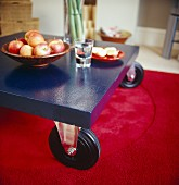 Apples in bowl on table with castors