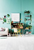 Sofa, secretary with shell chair and metal shelf with house plants, pictures of plant and animal motifs on green wall