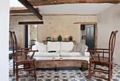 Patterned tiled floor in Mediterranean living room
