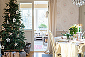Christmas tree in festively decorated living room