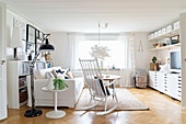 White furniture in bright living room with parquet floor