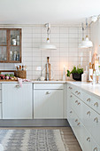 White country-house kitchen with natural accessories