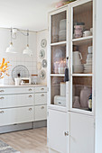 Cupboard in white country-house kitchen
