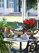 Gardening tools on table in garden