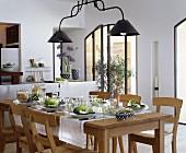 Set oak table in Mediterranean dining room