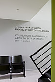 Quote on wall above vintage cinema seats in foyer with epoxy resin floor
